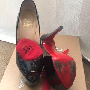 Original Christian Louboutin patten leather heels.